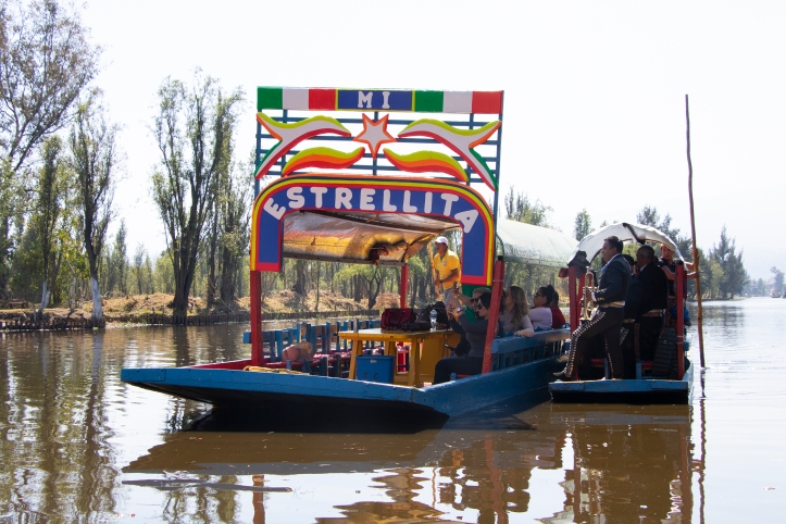 trajineras in the colourful canals of Xochimilco